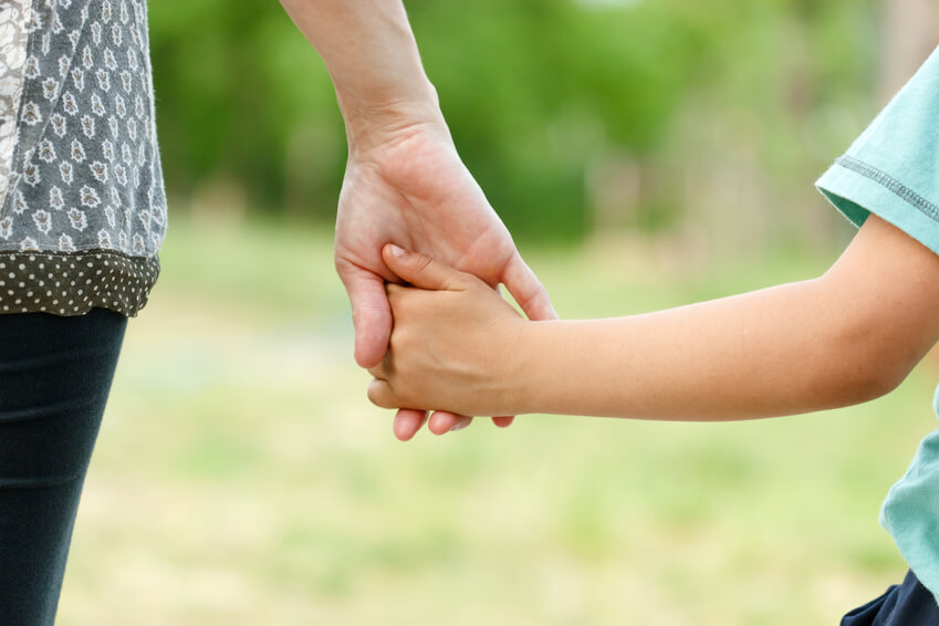 parent holding childs hand 1