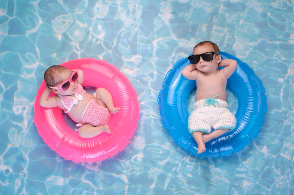 Baby Twin Boy and Girl Floating on Swim Rings 628951466 2125x1414 1024x681 1