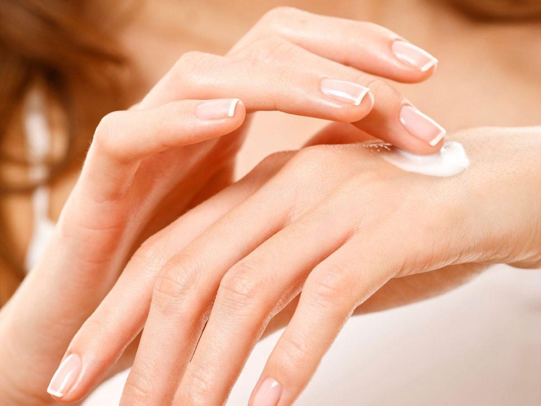 woman applying hand cream