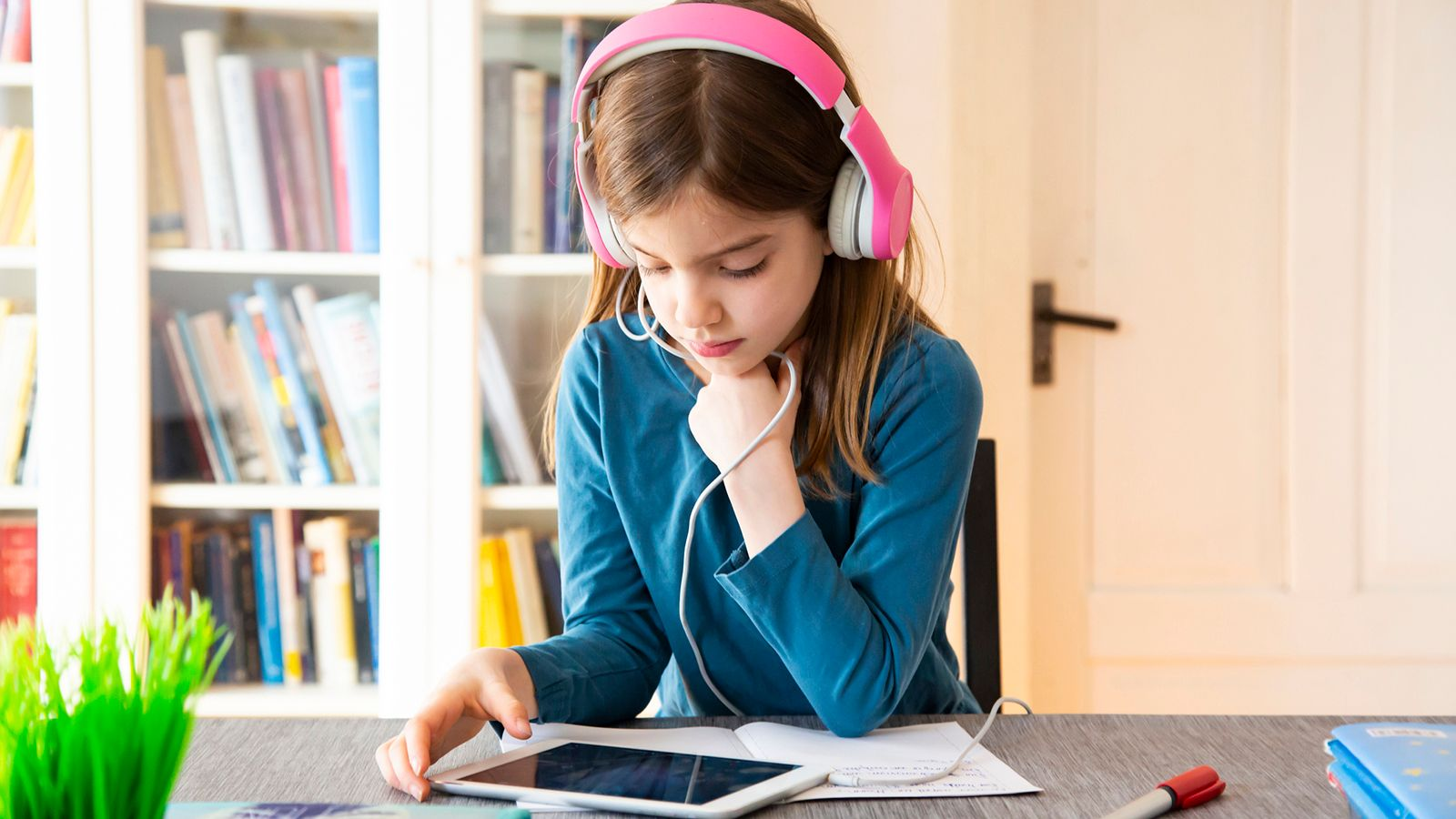 1019 young girl doing online learning through educational app 1147337312